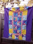 Kaleidoscope Quilt with Polka Dot back