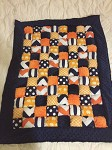 Lincoln's Navy and Orange Puff Quilt