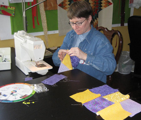 Colette piecing her nine patch block.