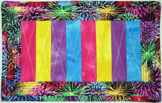 http://quiltinggallery.com/wp-content/uploads/2011/01/fireworks-mug-rug.jpg