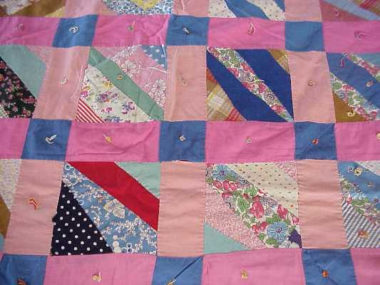 "Pink quilt used by author Linda Hubalek while growing up in the ""Butter in the Well"" house."