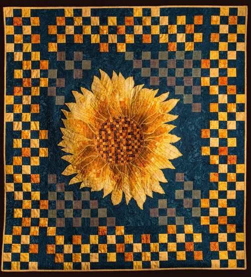 The petals are all appliquéd from the Bargello run which amplifies the Bargello to create a very strong sense of movement within the flower itself.