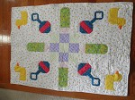 Ducks and Rattles baby quilt